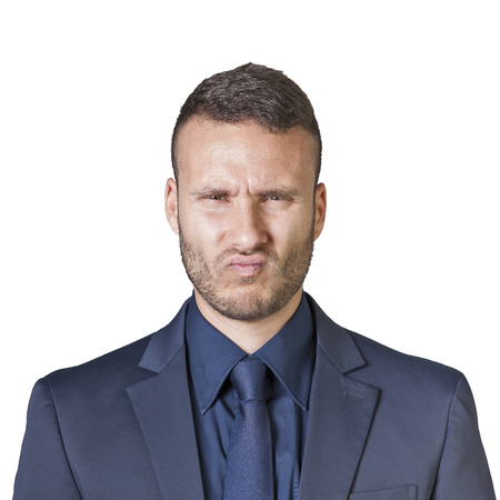 facial expressions of a young businessman isolated on a white background photo