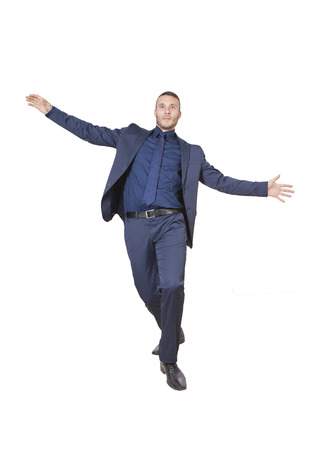young businessman acrobat isolated on a white background photo