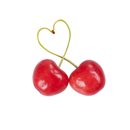 two Heart-shaped sweet cherries isolated on a white background