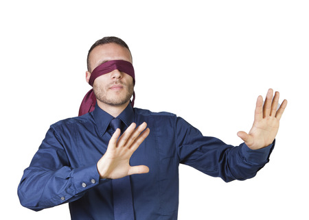 young businessman in blindfold isolated on a white background Standard-Bild