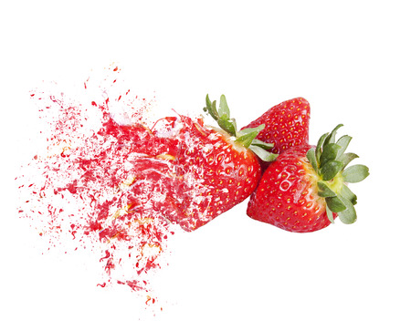 explosion strawberries in group on a white background