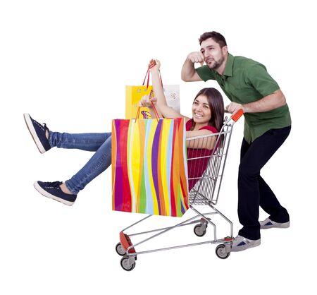 happy woman and desperate man with hand cart photo