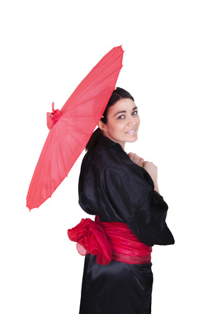 geisha with red umbrella and bow on a white background photo