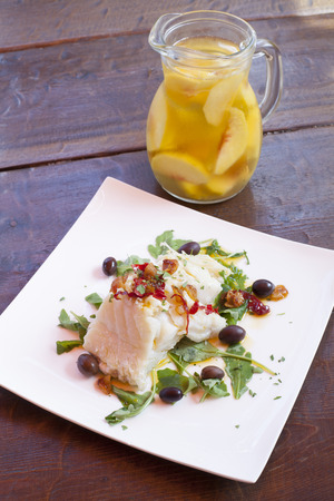 potato cod: Fish dish - boiled fish fillet with white wine and peach Stock Photo
