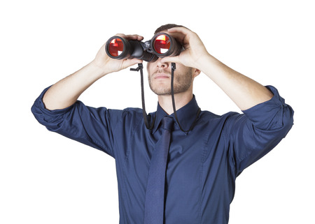 a young businessman with binoculars isolated on a white background