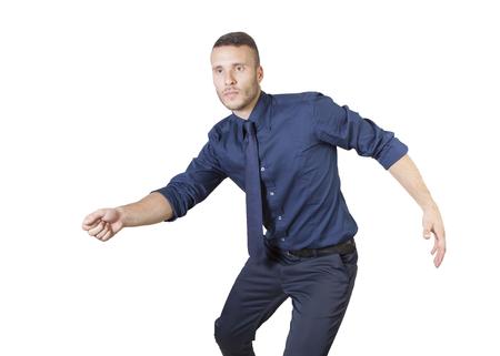 a young businessman lounching like a tennis shot photo
