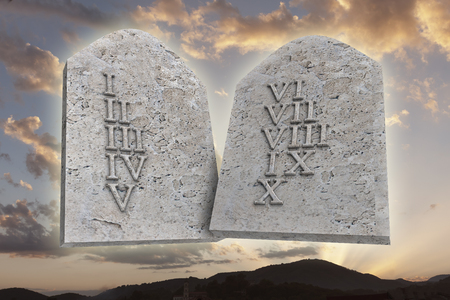 hebrew script: the ten Commandments on a sunset background