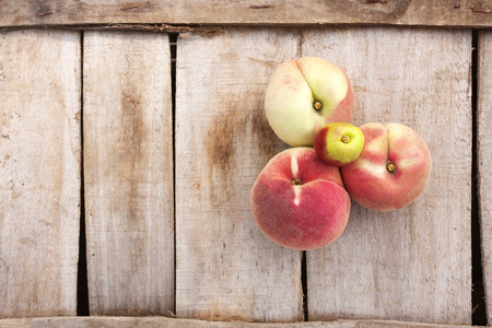 peach tree: white peach and on a wood backgronud