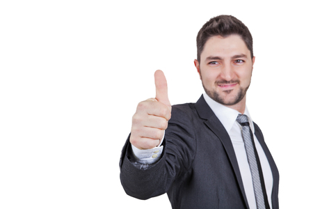 successfull: middle-aged smiling elegant businessman showing thumbs up