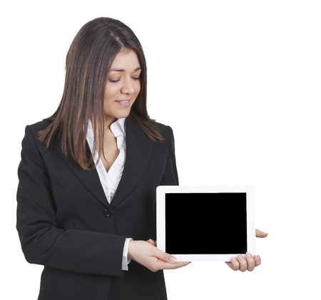 tailleur: middle-aged businesswoman with dark tailleur showing tablet Stock Photo