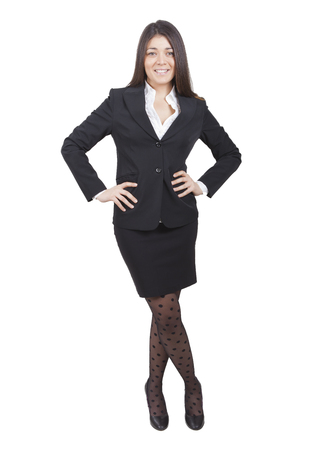 tailleur: young smiling businesswoman with dark tailleur standing Stock Photo