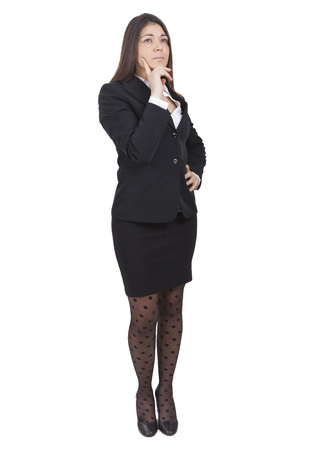 successfull: middle-aged caucasian businesswoman with dark tailleur thinking