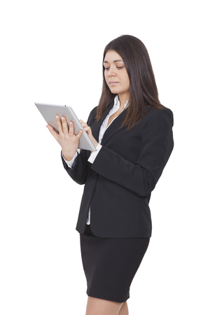 tailleur: a businesswoman with dark tailleur watching tablet Stock Photo