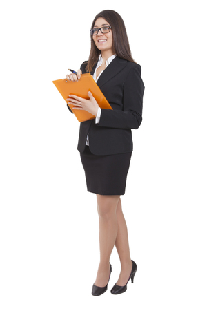 tailleur: Businesswoman with a dark tailleur reading some documents Stock Photo
