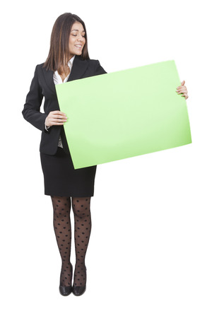 tailleur: A businesswoman is keeping big green signboard