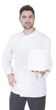 toque blanche: young caucasian chef holds up a toque blanche