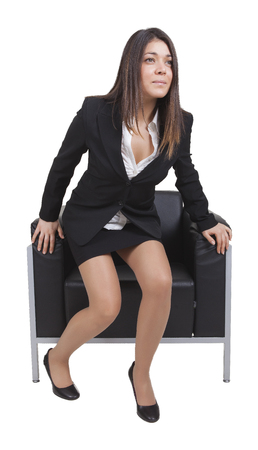 levantandose: Businesswoman is getting up from black armchair