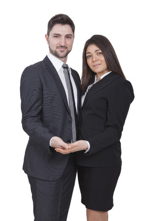 Young businesswoman and businessman holding something in their hands Stock Photo