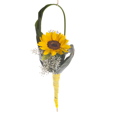 Floreal composition with sunflower and handbag made of aspidistra's leaf