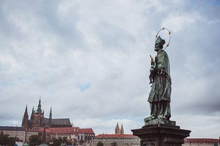 The prototypical statue of John of Nepomuk at Charles Bridge in Prague