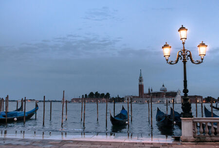 sited: Venice is a city in northeastern Italy sited on a group of 117 small islands separated by canals and linked by bridges. Stock Photo
