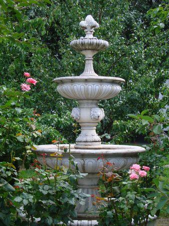 A tiered classic fountain in the garden Banco de Imagens - 7090851