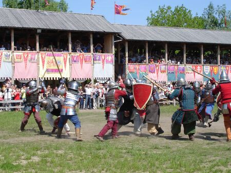 Ukraine - May the 21, 2011: International Festival - Kievan Rus - XIII century. A fight of medieval  knights during a tournament Banco de Imagens - 9889547