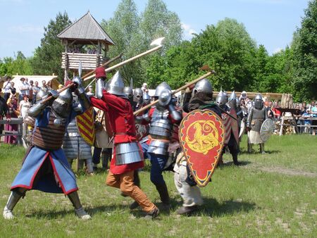 Ukraine - May the 21, 2011: International Festival - Kievan Rus - XIII century. A fight of medieval  knights during a tournament Banco de Imagens - 9889550