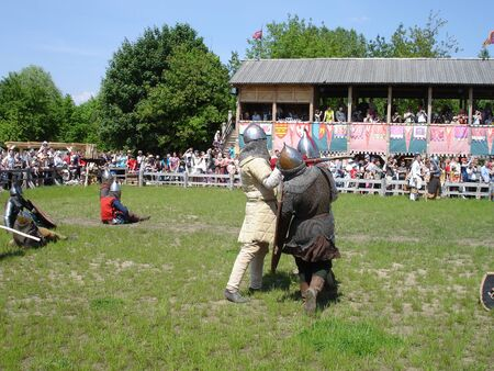 melee: Ukraine - May the 21, 2011: International Festival - Kievan Rus - XIII century. A fight of medieval  knights during a tournament