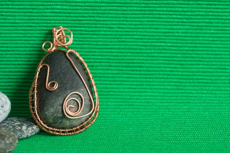 pendent: Handmade pendent from a stone and a wire Stock Photo