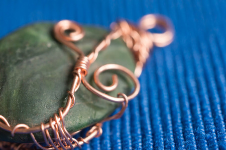 pendent: Handwork pendent from a stone and a wire close up Stock Photo