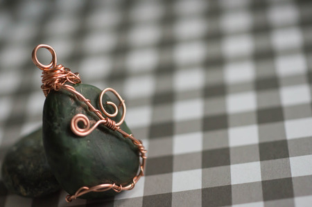 checkered background: Wire wrapped pendant on a checkered background