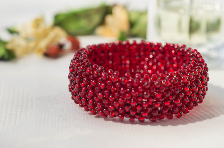 wattled: Wattled bracelet from red beads close up