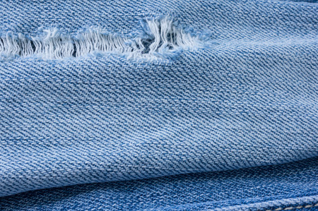 torn jeans: Old torn jeans texture. Textile background