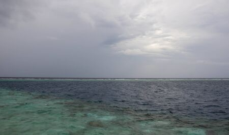indian ocean: Indian Ocean and sky in clouds during the rainy season