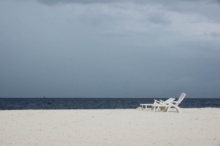cloudy day: Empty beach on a cloudy day in the rainy season