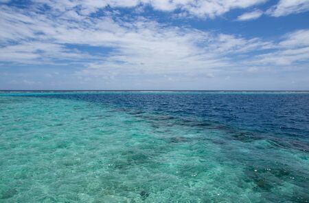 indian ocean: Turquoise water of the Indian Ocean and cloudy sky Stock Photo