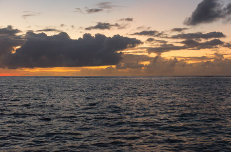 tropics: The sky over the ocean at sunset in the tropics Stock Photo
