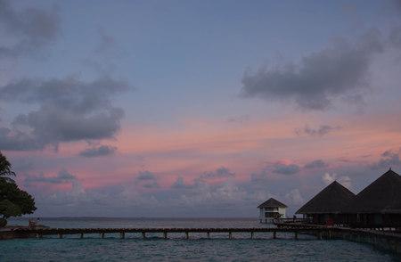 pink sunset: Beautiful pink sunset over a tropical resort