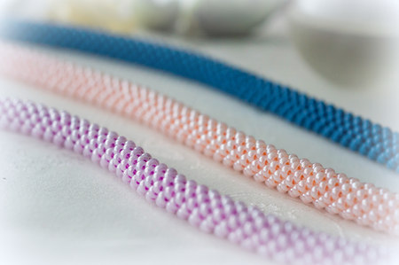 fragments: Fragments of handmade beaded necklace on textile background