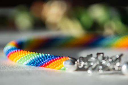 seed beads: Crochet necklace made from seed beads rainbow colors Stock Photo