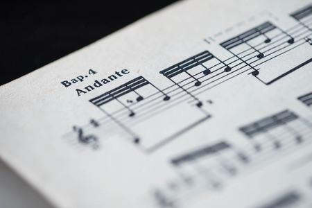 tempo: Musical tempo Andante in a music book close up
