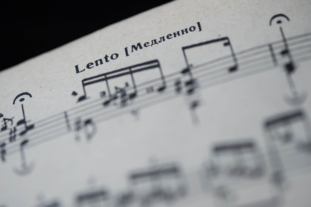 tempo: Musical tempo Lento in a music book close up Stock Photo