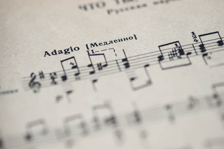 tempo: Musical tempo Adagio in a music book close up