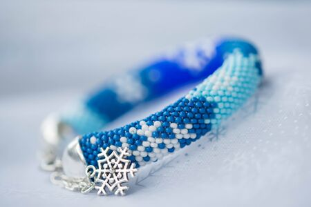 beaded: Handmade beaded bracelet with the image of snowflakes