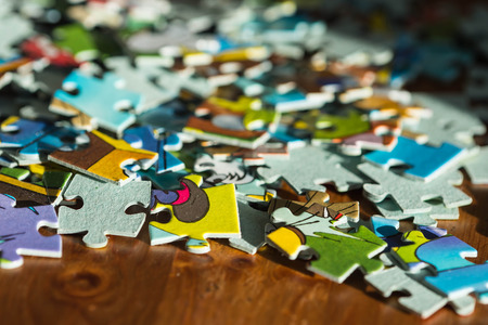 coincidence: Scattered childrens puzzle on a wooden table