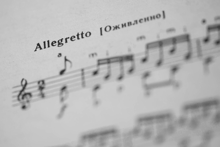 tempo: Musical tempo Allegretto in a music book close up