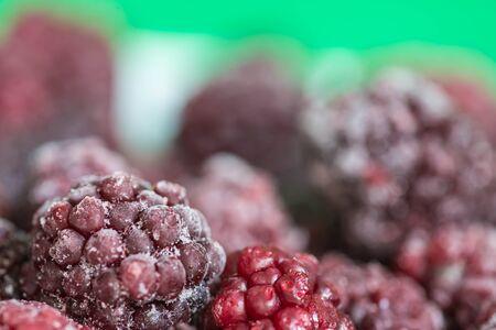 crimson colour: The frozen berries of a blackberry close up Stock Photo