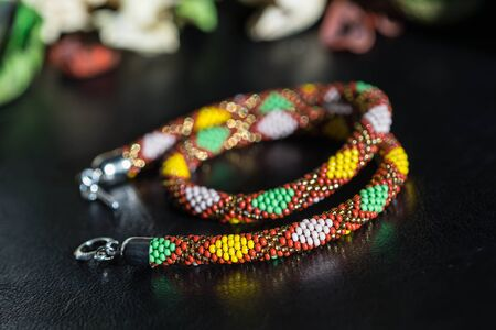 beaded: Handmade beaded necklace with geometrical pattern close up Stock Photo