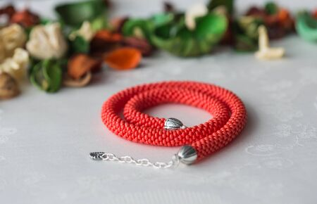 ladylike: Handmade beaded necklace red color close up Stock Photo